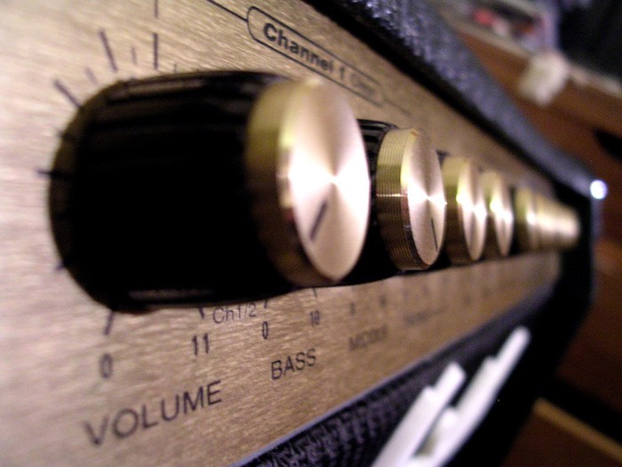 image: stereo amplifier volume knob that goes to 11